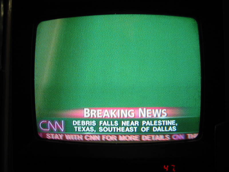 Photograph of my television showing CNN's coverage of the Space Shuttle Columbia disaster