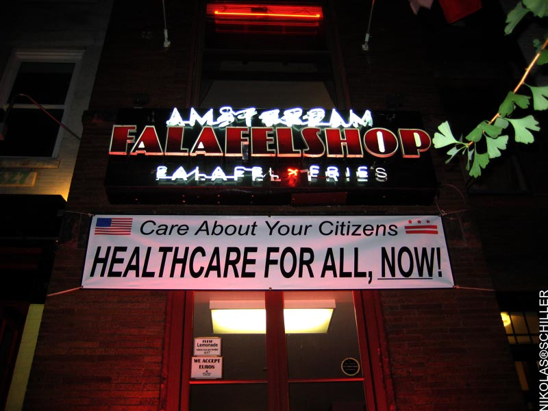 Banner at Amsterdam Falafel in Adams Morgan: Care About Your Citizens / Healthcare For All, Now!