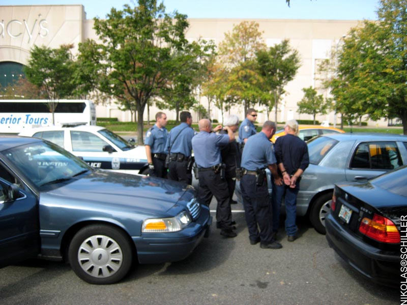 Photograph of one of the farmers being arrested outside of the DEA Headquarters
