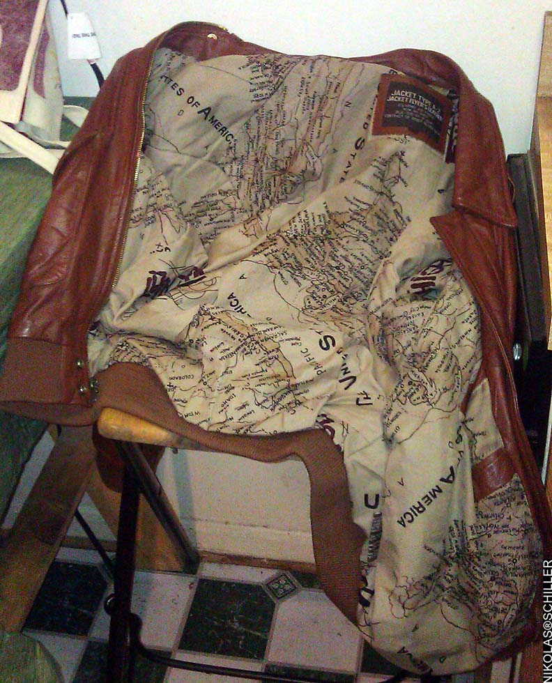 Photograph of a leather jacket with a map as the fabric lining