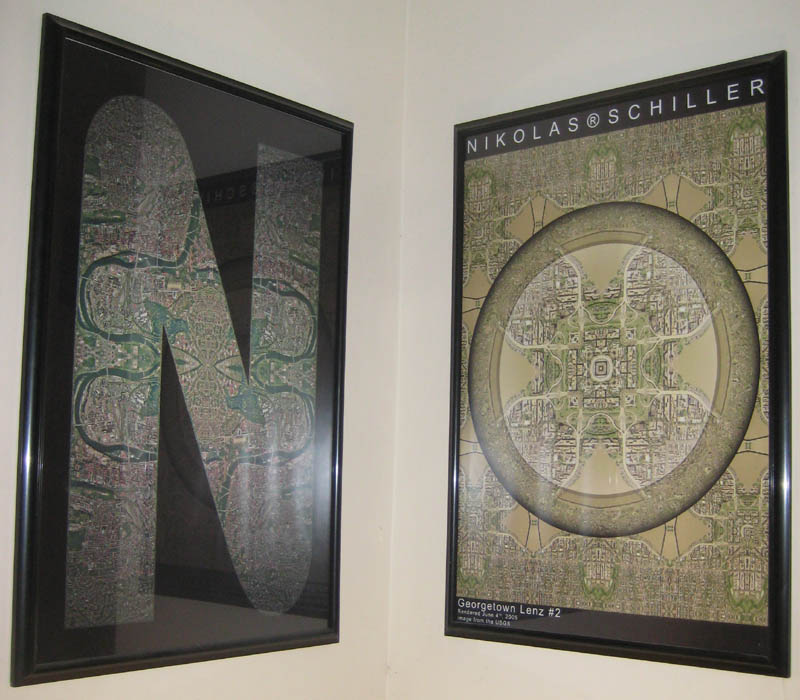 Photograph of two framed maps spelling out the word NO in my hallway
