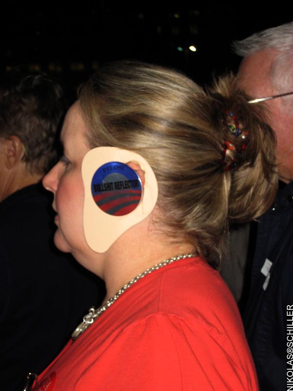 A woman with fake over-sized ears with Obama's logo and the text: Pelosi Bullshit Reflector