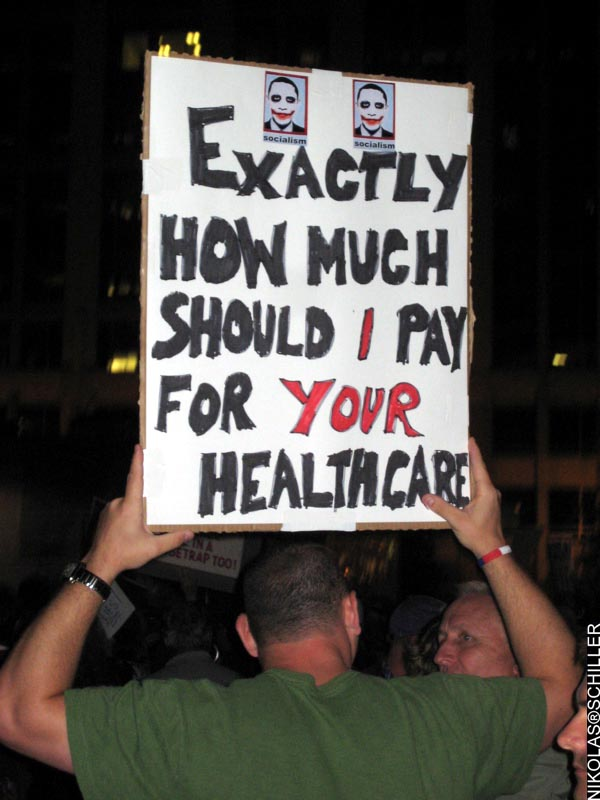A sign that reads: Exactly how much should I pay for your healthcare