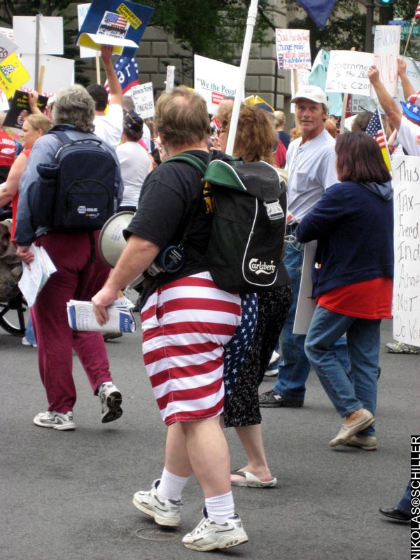 Photograph of an overweight person wearing shorts made out of the American flag