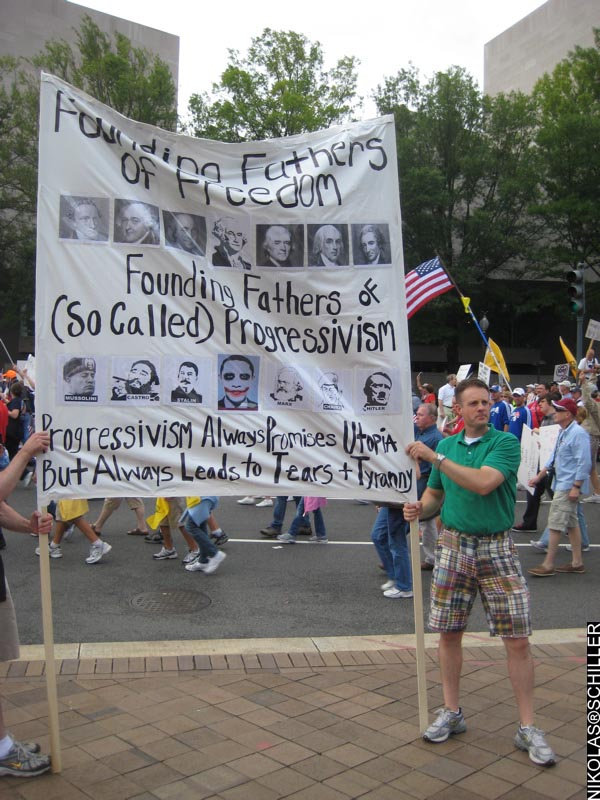Photograph of large banner that says: Founding Fathers of Freedom vs. Founding Fathers of So-Called Progressivism - Progressivism always promises utopia but always leads to tears + tyranny