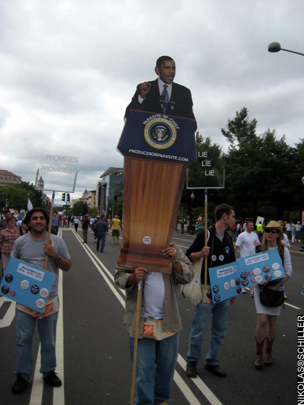 A Photograph of a mock Obama speech, with a podium and two teleprompters