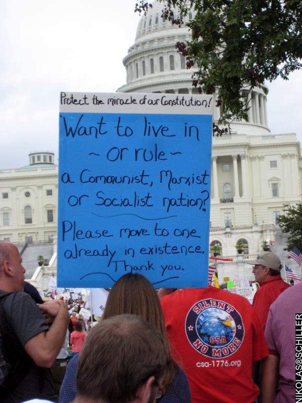 PPhotograph of a sign saying: Protect the miracle of our Constitution. Want to live in - or rule - a communist, marxist, or socialist nation?  Please move to one already in existence. Thank you