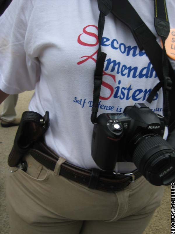 Photo sof a woman wearing an empty gun holster